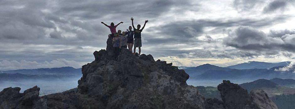 Hiker celebrating from Cerro Quemado peak, Quetzaltenango